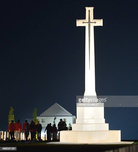 People stand in front of the Australian War Memorial during a dawn service in the northern French city of VillersBretonneux on April 25 to...