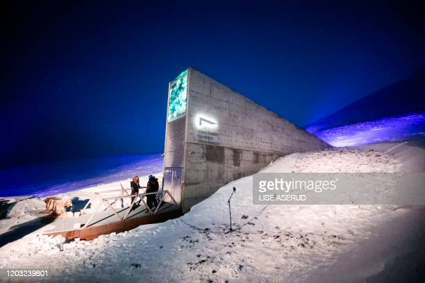 TOPSHOT People stand in front of the entrance to the international gene bank Svalbard Global Seed Vault on February 25 2020 outside Longyearbyen on...