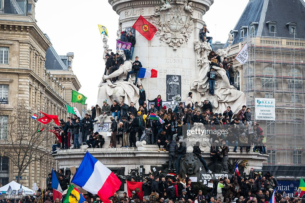People stand in front of the 'Statue de la Republique' prior to a unity rally in Paris led by French president Francois Hollande and other world leaders following the recent terrorist attacks, January 11, 2015 in Paris, France. An estimated one million people converged in central Paris for the Unity March in solidarity with the 17 victims of this week's terrorist attacks which began on Wednesday, January 8, 2014 with an attack on French satarical magazine Charlie Hebdo and continued through Friday with attacks at a printing company and a Kosher supermarket. Three suspects were killed in seiges while a fourth, Hayat Boumeddiene, 26, is wanted in connection with the murder of a policewoman.