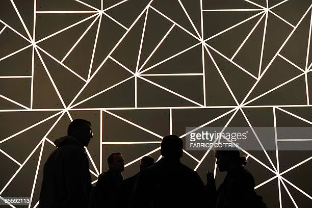 People stand in front of the TAG Heuer booth during the press day at the Baselworld 2009 watch and jewellery show on March 25 2009 in Basel The...