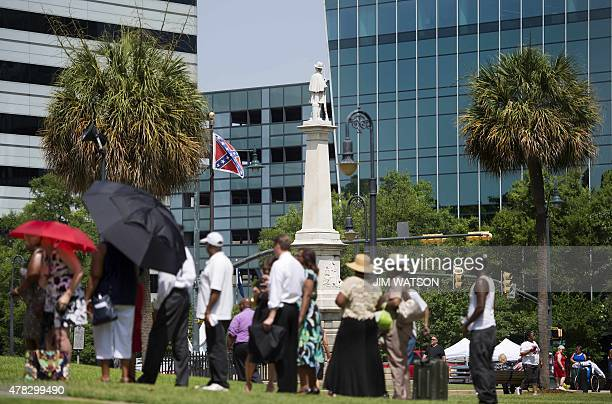 People stand in line as the funeral procession for Emanuel AME Church pastor and South Carolina State Sen Clementa Pinckney arrives at the Statehouse...