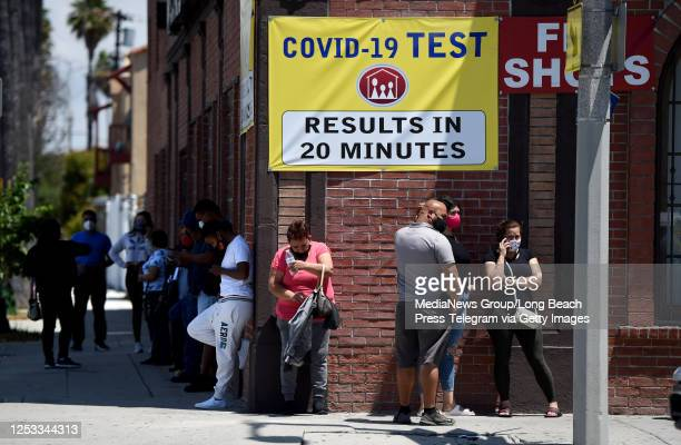 People stand in line at a clinic offering quick coronavirus testing for a fee in Wilmington on Monday June 29 2020