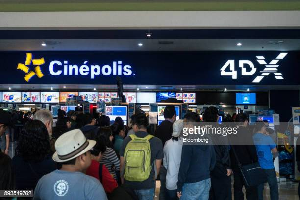 People stand in line at the Cinepolis de Mexico SA ticket counter inside the Forum Buenavista mall in Mexico City Mexico on Monday Nov 20 2017 The...