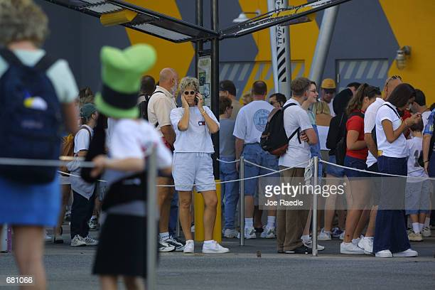 People stand in line at the Test Track ride at Walt Disney's Epcot Center November 11 2001 in Orlando Florida