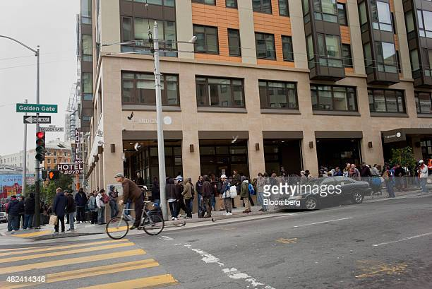 People stand in line for a free meal in front of St Anthony's dining hall in the Tenderloin district of San Francisco California US on Monday Jan 19...