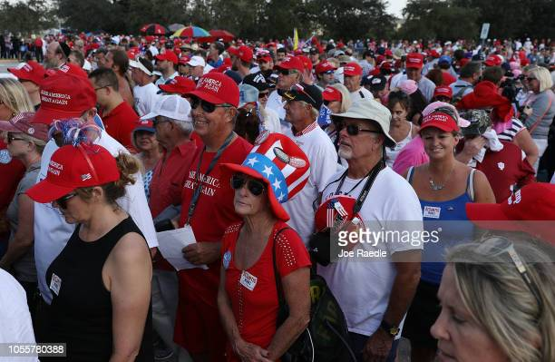 People stand in line for President Donald Trump's campaign rally at the Hertz Arena on October 31 2018 in Estero Florida President Trump continues...