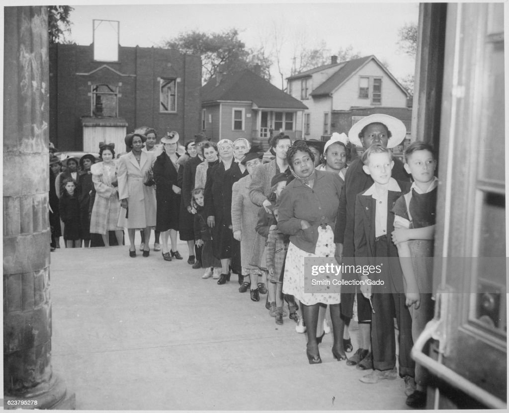 People stand in line for sugar rationing during World War II, 1942. (Photo via Smith Collection/Gado/Getty Images).