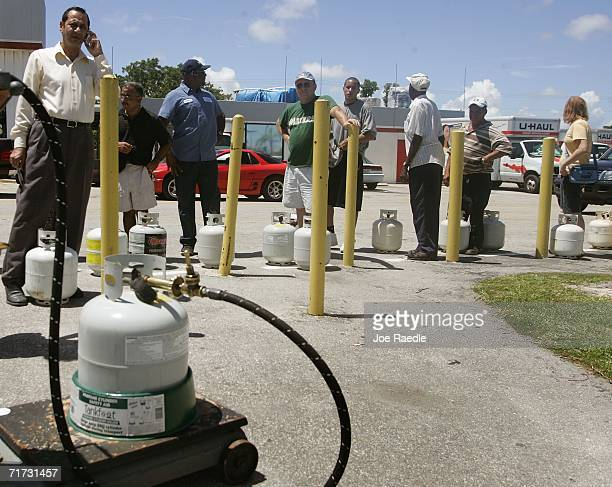 People stand in line to fill their propane tanks as they prepare for the approaching Tropical Storm Ernesto that is threatening South Florida August...