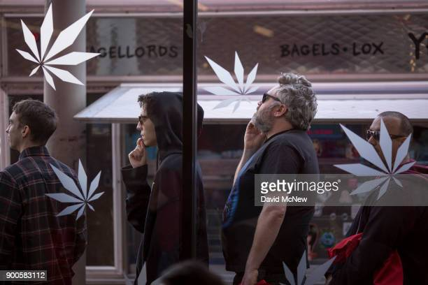 People stand in line to get into MedMen one of the two Los Angeles area pot shops that began selling marijuana for recreational use under the new...