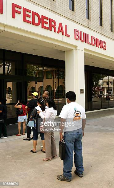 People stand in line to get into the Internal Revenue Service office for help with their income taxes filings on April 15 2005 in Van Nuys California...