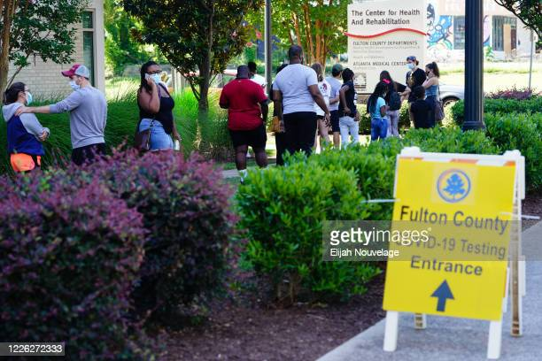 People stand in line to get tested for COVID-19 at a free walk-up testing site on July 11, 2020 in Atlanta, Georgia.With nearly 4,500 new cases of...