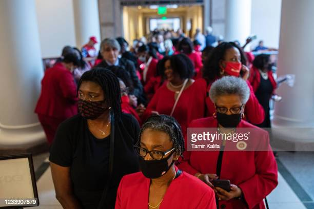 People stand in line to testify before the House Select Committee on Constitutional Rights and Remedies, which began hearings on bail reform and...