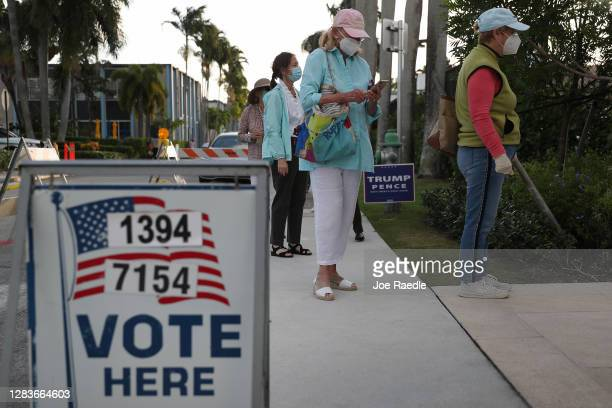 People stand in line to vote at the Morton and Barbara Mandel Recreation Center on November 03, 2020 in Palm Beach, Florida. After a record-breaking...