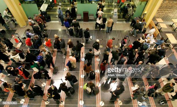 People stand in line while they inch closer to the security check point at Ronald Reagan Washington National Airport November 23 2005 in Arlington...