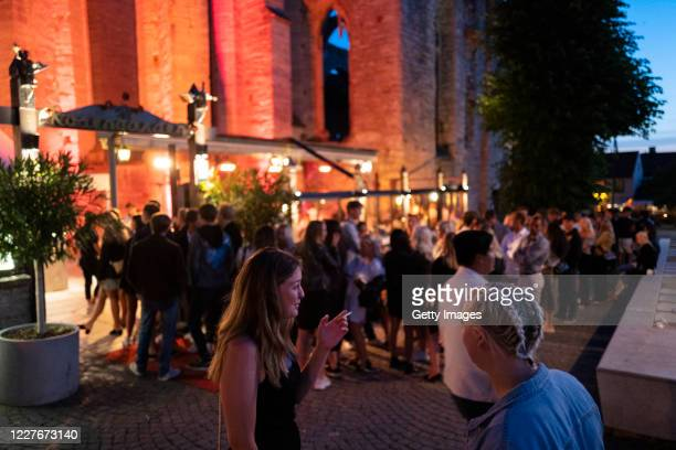 People stand in line without social distancing outside a restaurant on July 17, 2020 in Gotland, Sweden. Sweden largely avoided imposing strict...