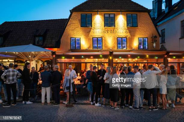 People stand in line without social distancing outside a restaurant on July 17 2020 in Gotland Sweden Sweden largely avoided imposing strict lockdown...