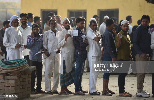 People stand in queues to cast their votes during the first phase of the Lok Sabha elections People stand in queues to cast their votes during the...