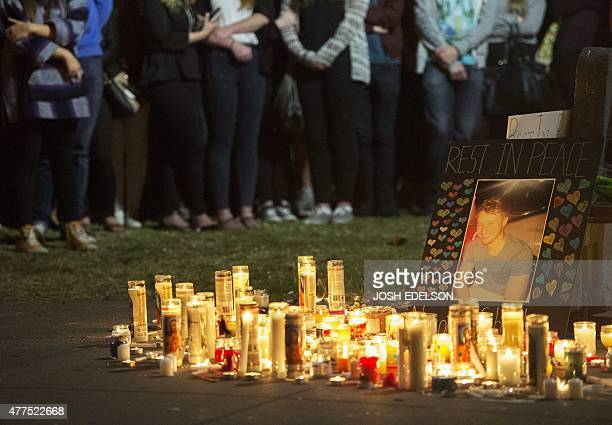 People stand in silence at a memorial for those who lost their lives after a balcony gave way in Berkeley California on June 17 2015 Dry rot and...