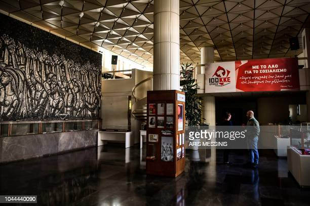 People stand in the hall of the Greek Communist party compound in Athens on September 26 2018 The Greek Communist party KKE turns 100 next month a...