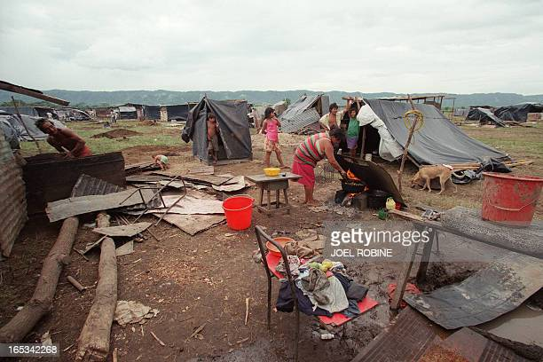 People stand in the 'New Life Quarter a camp of plastic sheeting and shacks installed 09 November 1998 at Ciudad Sandino 15 kilometers from Laka...