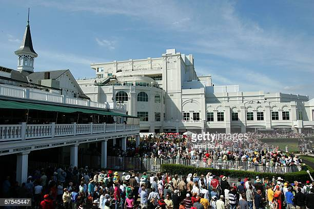 People stand in the paddocks before a race during the 132nd Kentucky Derby on May 6 2006 at Churchill Downs in Louisville Kentucky