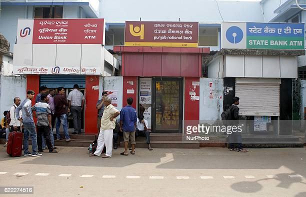 People stand in the queue to enter into the bank to withdraw money and exchange the discontinued notes as ATMs till now not working in the eastern...