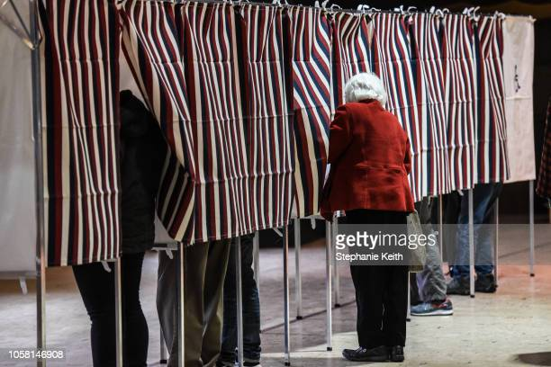 People stand in voting booths while casting their vote at the Montpelier Town Hall on November 6 2018 in Montpelier Vermont Turnout is expected to be...