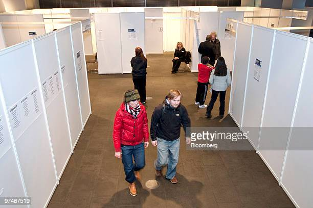 People stand inside a polling station as they prepare to vote in the Icelandic national referendum in Reykjavik Iceland on Saturday March 6 2010...
