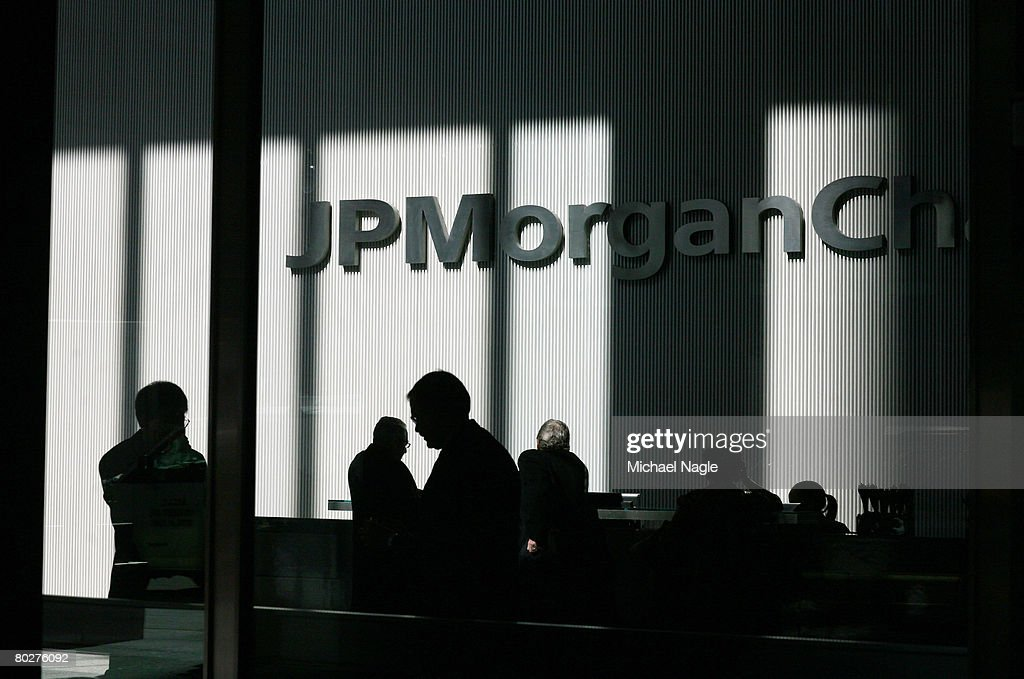 People stand inside the offices of JP Morgan Chase on March 17, 2008 in New York City. JP Morgan Chase bought Bear, Stearns & Co, for $2 a share, with help of $3O billion in financing of Bear, Stearns assets from the U.S. Federal Reserve.