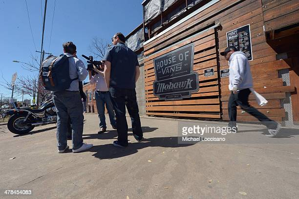 People stand near the scene of a deadly car accident at the South by Southwest Music Film and Interactive Festival on March 13 2014 in Austin Texas...