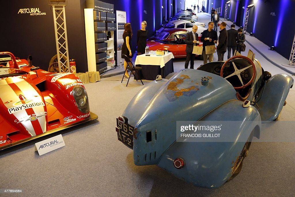 People Stand Next To A Bugatti Type Brescia Circa On - Car show display stand for sale