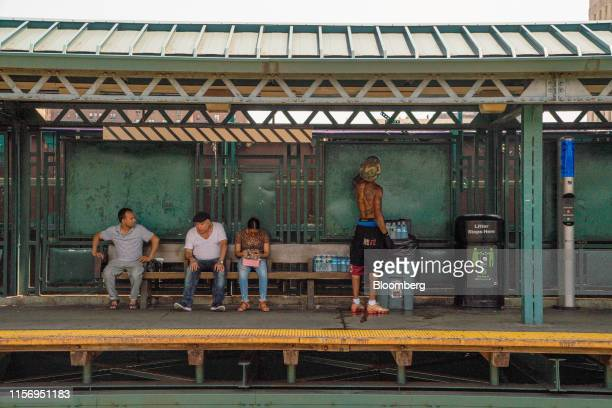 People stand on a subway platform in the Bronx borough of New York US on Saturday July 20 2019 Consolidated Edison Inc is forecasting record power...