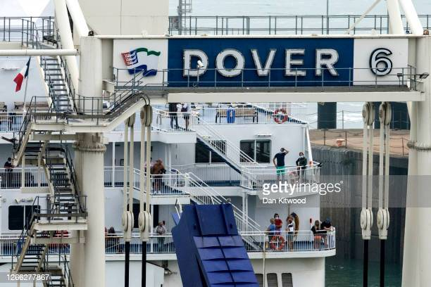 People stand on deck as a ferry returns to Dover port from France on August 14, 2020 in Folkestone, United Kingdom. The UK government, citing a rise...
