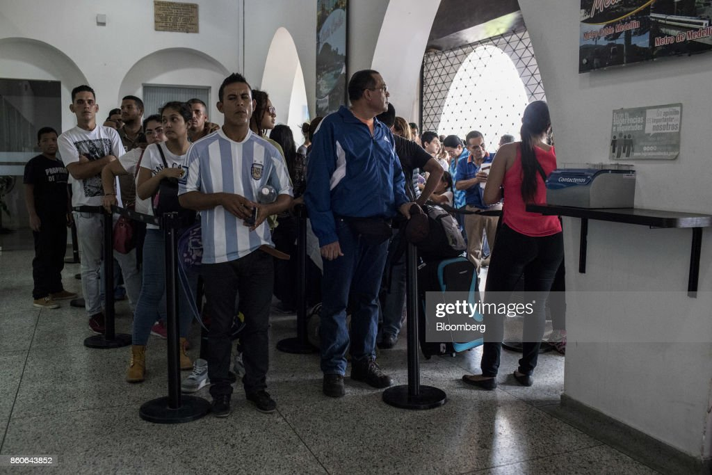 People stand on line inside the Immigration office in the town of Villa del Rosario, Cucuta, Colombia, on Thursday, Sept. 21, 2017. For weeks, Venezuelans have been flocking by the busload to San Antonio del Tachira, a border town of some 62,000 residents, fleeing as President Nicolas Maduro consolidates autocratic power. According to Colombia's migration authority, the number of foreigners entering Cucuta, the first major city across the bridge, more than doubled this summer. Photographer: Nicolo Filippo Rosso/Bloomberg via Getty Images