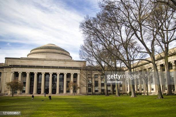 People stand on the lawn outside Building 10 on the Massachusetts Institute of Technology campus in Cambridge Massachusetts US on Monday April 20...