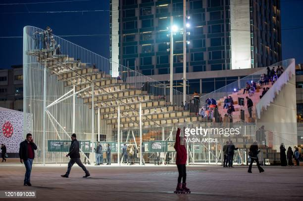 """People stand on the """"Meeting Point"""", a temporary designed mobile public forum and exhibition center on Febuary 18, 2020 near Gezi Park in Istanbul."""