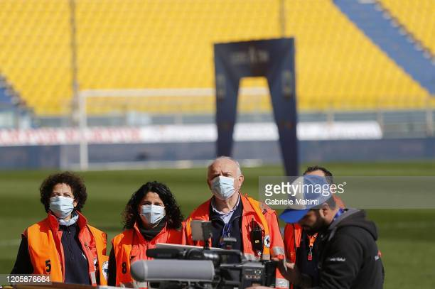 People stand on the pitch wearing face masks during the Serie A match between Parma Calcio and SPAL at Stadio Ennio Tardini on March 8 2020 in Parma...