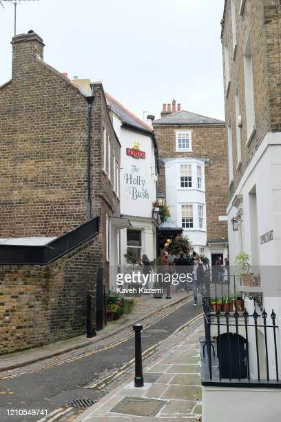 People stand outside a Holly Bush pub located in a narrow alley way in Hampstead village on November 3 2019 in London United Kingdom