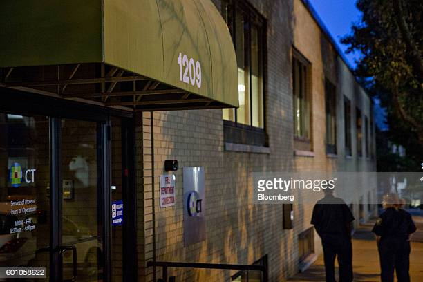 People stand outside of 1209 North Orange Street in Wilmington, Delaware, U.S., on Tuesday, Aug. 23, 2016. Inside 1209 North Orange are little more...