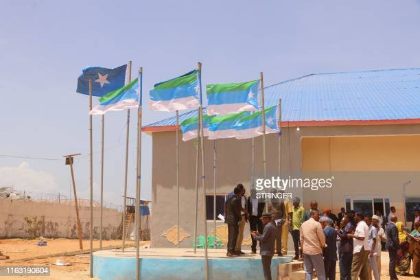 People stand outside of the election hall in Kismayo, the interim capital of Jubaland State, on August 22, 2019. - Madobe was reelected as the...