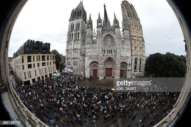 People stand outside Rouen's cathedral on August 2 2016 during the funeral of Jacques Hamel the priest who was killed in a church in...