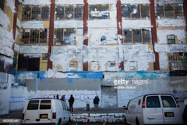 People stand outside the 5 Pointz building which was painted over by developers in the dead of night after two decades serving as the mecca for...