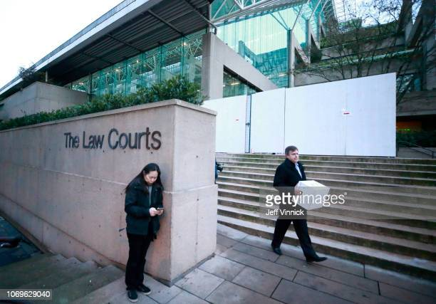 People stand outside the BC Supreme Courthouse during a break in proceedings while attending the bail hearing for Huawei Technologies Chief Financial...