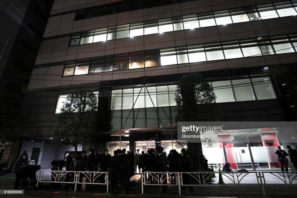 People stand outside the building that houses the headquarters of Coincheck Inc. stands in Tokyo, Japan, on Tuesday, Feb. 13, 2018. Cryptocurrency exchange Coincheckusers withdrew 40.1 billion yen ($373 million) from the cryptocurrency exchange on Tuesday, the first day customers were allowed to pull out in the wake of the cyber-theft of about$500 millionlast month. Photographer: Kiyoshi Ota/Bloomberg via Getty Images