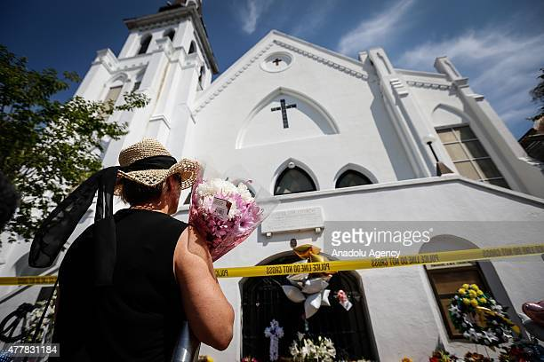 People stand outside the Emanuel AME Church to pay respect to the nine shooting victims on June 19 in Charleston South Carolina USA