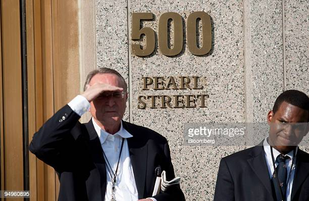 People stand outside the entrance to federal court at 500 Pearl Street in New York US on Monday June 29 2009 Bernard Madoff founder of Bernard L...