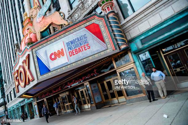 People stand outside the Fox Theatre ahead of the democratic debates in Detroit, Michigan on July 29, 2019. - Democrat presidential candidates will...