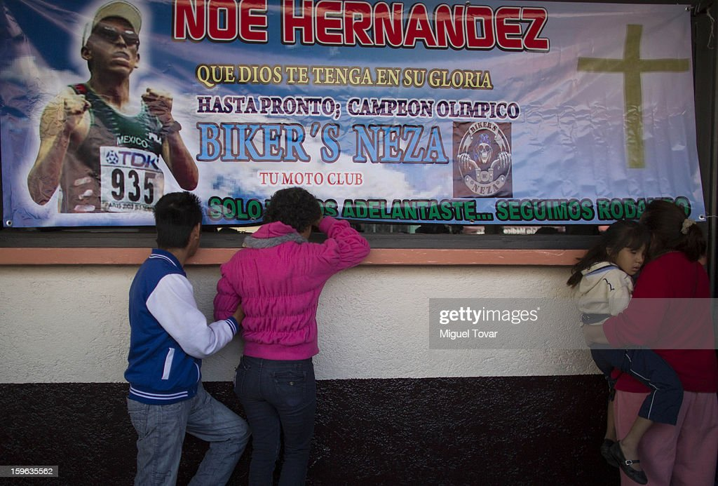 People stand outside the funeral during the memorial service honoring Noe Hernandez on January 17, 2013. Hernandez died yesterday of a heart attack after recovering from a shot in the head received last December 30 near his house at the outskirts of Mexico City, Mexico.