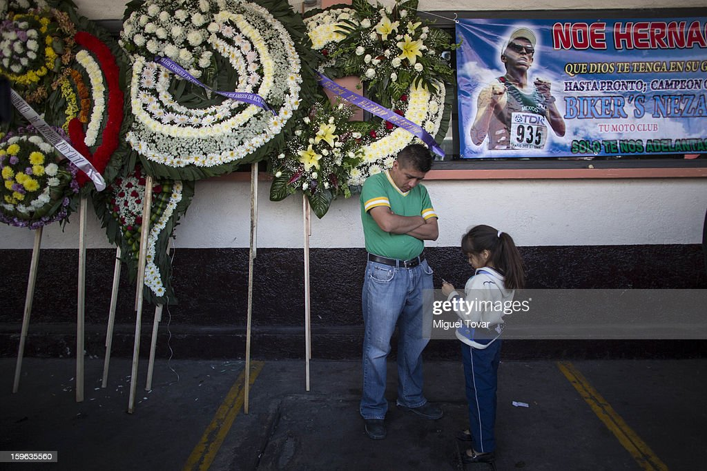 People stand outside the funeral parlor during the memorial service honoring Noe Hernandez on January 17, 2013. Hernandez died yesterday of a heart attack after recovering from a shot in the head received last December 30 near his house at the outskirts of Mexico City, Mexico.