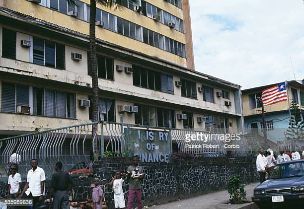 People stand outside the Ministry of Finance building in Monrovia during the Liberian Civil War Five percent of the Liberian population is descended...